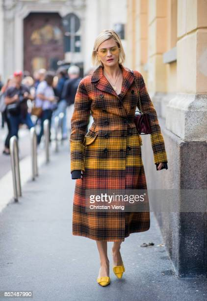 Pandora Skies wearing checked coat is seen outside Bottega Veneta during Milan Fashion Week Spring/Summer 2018 on September 23 2017 in Milan Italy