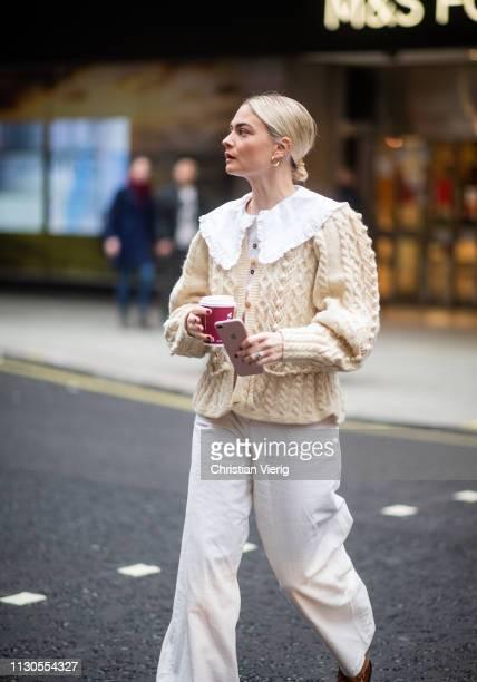 Pandora Sykes is seen wearing beige knit, white bag outside Roksanda during London Fashion Week February 2019 on February 18, 2019 in London, England.