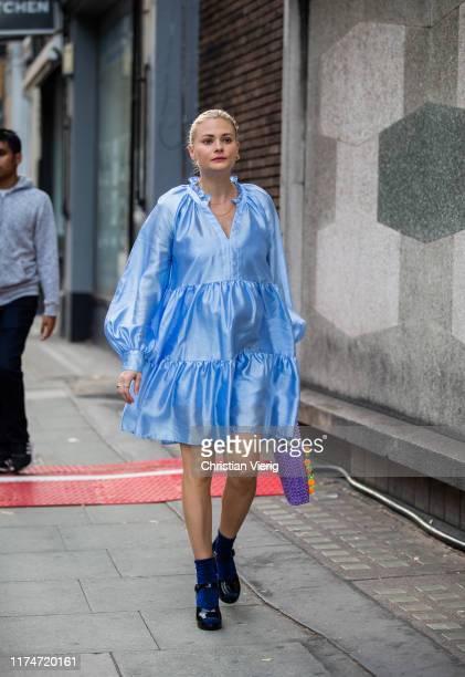 Pandora Sykes is seen wearing blue silk dress outside Rejina Pyo during London Fashion Week September 2019 on September 14, 2019 in London, England.