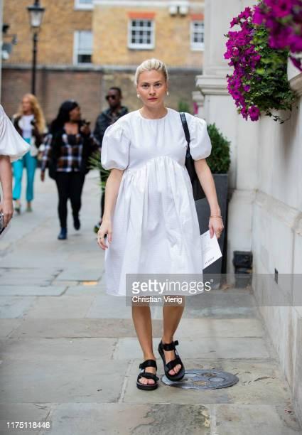 Pandora Sykes is seen wearing white dress outside Erdem during London Fashion Week September 2019 on September 16, 2019 in London, England.