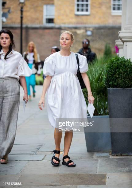 Pandora Sykes is seen wearing white dress outside Erdem during London Fashion Week September 2019 on September 16 2019 in London England
