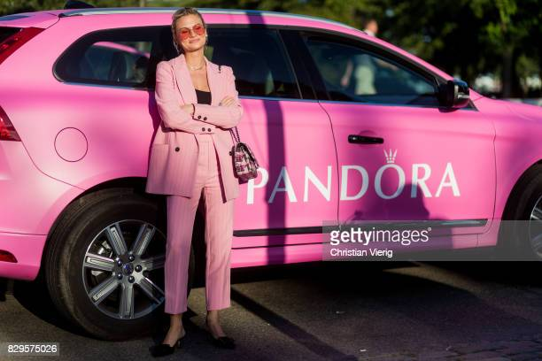 Pandora Sykes wearing a pink suit Chanel bag outside Saks Potts on August 10 2017 in Copenhagen Denmark