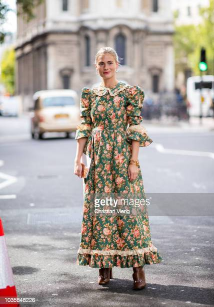 Pandora Sykes wearing maxi dress with floral print is seen outside Richard Quinn during London Fashion Week September 2018 on September 18 2018 in...