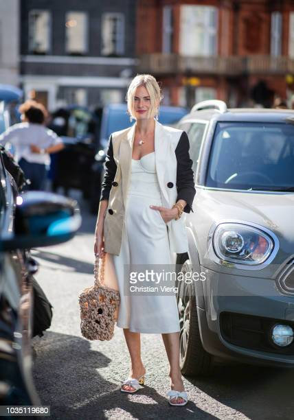 Pandora Sykes wearing white dress two tone jacket is seen outside Emilia Wickstead during London Fashion Week September 2018 on September 17 2018 in...