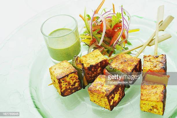 Paneer tikka with mint dip on plate