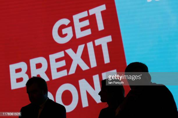 A panel discussion takes place on stage during the third day of the Conservative Party Conference at Manchester Central at Manchester Central on...