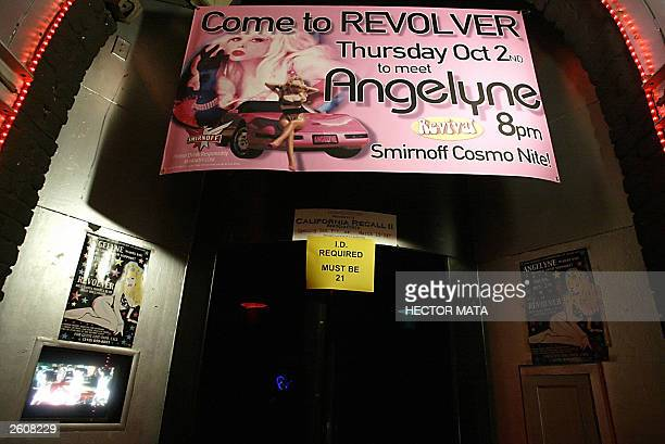 A panel is placed at the entrance of the club Revolver as it announces an event with Gubernatorial candidate Angelyne the 'Hollywood Billboard Queen'...