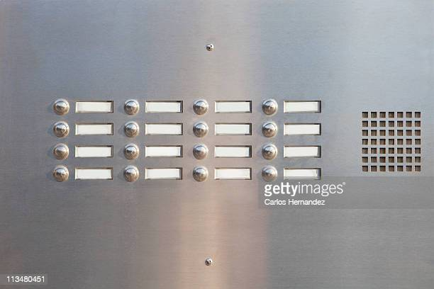 a panel of doorbells - intercom stock pictures, royalty-free photos & images
