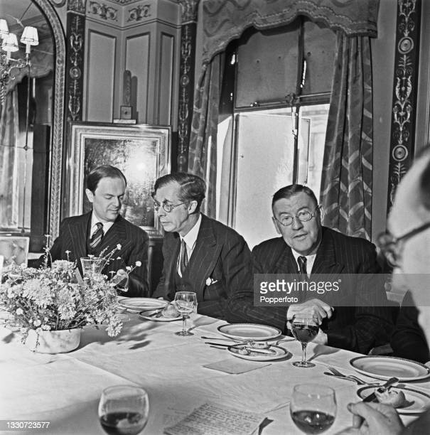 Panel of experts from the BBC Radio Brains Trust programme enjoy a Sunday luncheon at dining rooms in London during World War II on 20th October...