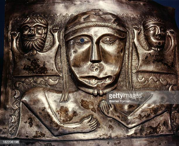 Panel of the Gundestrup cauldron A goddess flanked by smaller male and female figures Generally thought to be of Celtic origin brought to Denmark as...