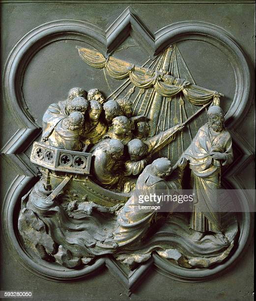 Panel of the North doors exterior detail Christ walking on water and saving Peter Gilded bronze by Lorenzo Ghiberti 1424 San Giovanni Baptistery...