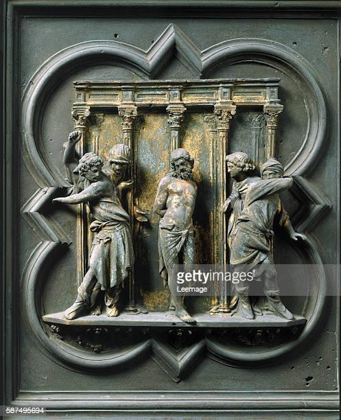 Panel of the North doors exterior detail The Flagellation of Christ gilded bronze by Lorenzo Ghiberti 1424 San Giovanni Baptistery Florence Italy
