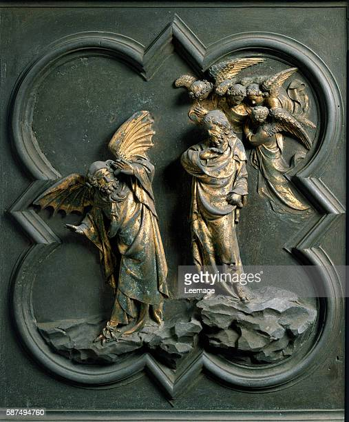 Panel of the North doors exterior detail The Temptation of Christ gilded bronze by Lorenzo Ghiberti 1424 San Giovanni Baptistery Florence Italy