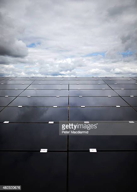 Panels reflect a cloudy sky at Landmead solar farm on July 29, 2015 near Abingdon, England. The 46 megawatt capacity installation was the largest in...