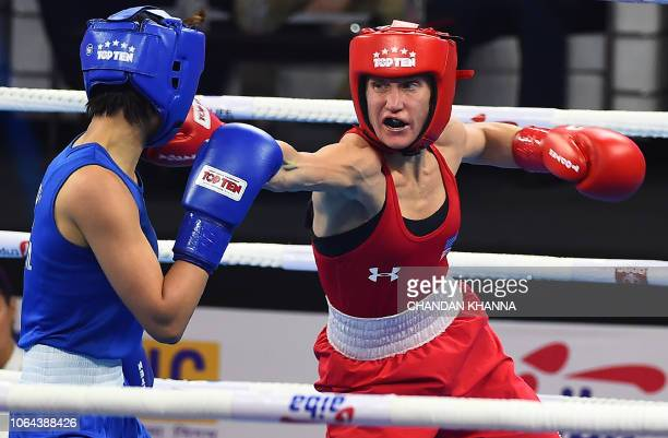 Pang Chol Mi of North Korea and Virginia Fuchs of the US compete during their 51 kg category semifinal fight at the 2018 AIBA Women's World Boxing...