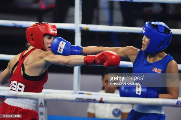 Pang Chol Mi of the North Korea and Virginia Fuchs of USA compete during their women's Fly category semifinal fight at the 2018 AIBA Women's World...