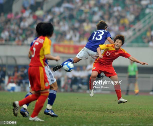 Pang Fengyue 17# of China in action against Yamaguchi Mami 13# of Japan during the AFC Women's Asian Cup Final between China and Japan at Chengdu...