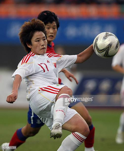 Pang Fengyue of China competes against Park Hee Young of South Korea at the women's football bronze medal during the 16th Asian Games in Guangzhou on...