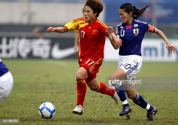 Pang Fengyue of China fights for a ball with Homare Sawa of Japan in action during the AFC Women's Asian Cup Final between China and Japan at Chengdu...