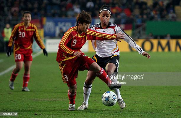 Pang Fengyue of China is challenged by Nicole Banecki of Germany during the women international friendly match between Germany and China at the...