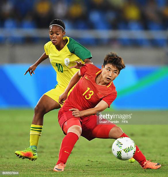Pang Fengyue of China is challenged by Silindile Ngubane of South Africa during the Olympic Women's Football match between South Africa and China PR...