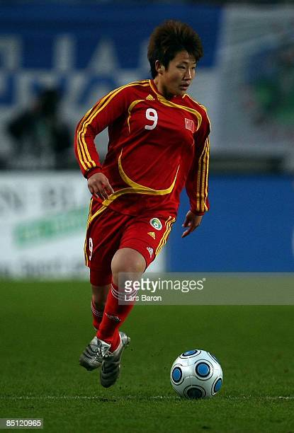 Pang Fengyue of China runs with the ball during the women's international friendly match between Germany and China at the Schueco Arena on February...