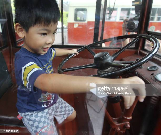 Pang Siufung 3yrold poses for picture with the first doubledecker bus of The Kowloon Motor Bus during the opening ceremony of 'Journey with you HK...