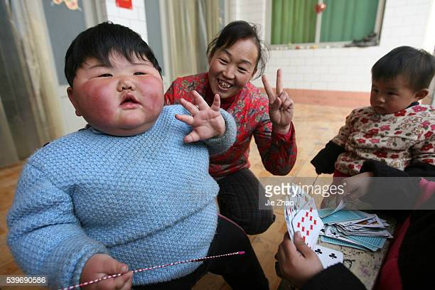 Pang Ya a 2year old girl who weighs 415 kilogrammes is seen with her grandmother at home in Yuncheng Shanxi province February 27 2010 The girl is...