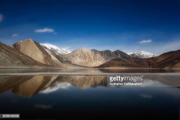 Pangong lake reflect under dark blue sky
