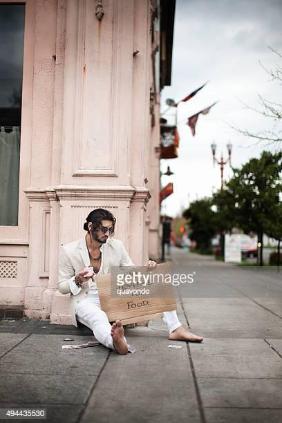 Panhandler Levitating au coin de rue