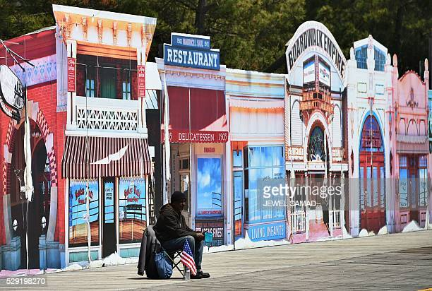 A panhandler waits in front of a cutout of shops on the boardwalk in Atlantic City New Jersey on May 8 2016 Atlantic City the famous US gambling...