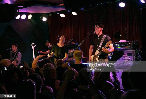 Panic At the Disco performs onstage during a special sold out intimate show at a small venue named Radio Radio on August 14 2013 in Indianapolis...