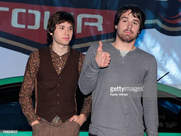 Panic at the Disco's guitarist Ryan Ross and bassist Jon Walker pose onstage during the announcement for Panic at the Disco's headlining of the 2008...