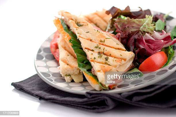 Panini sandwich with salad, served on a plate