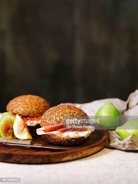 panini with gorgonzola cheese, ham and figs - シード ストックフォトと画像