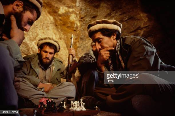 1985 Panjshir Valley Afghanistan Commander Massoud head of the Afghan resistance against the Soviet invasion plays chess with a group of mujaheddin...