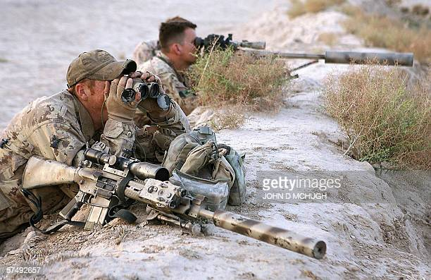 A Canadian sniper team scan the landscape during an Afghanled operation to arrest suspected Taliban operating in the Panjwayi district of southern...