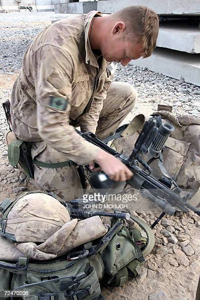 Canadian soldiers from A Company 2nd Princess Patricia's Canadian Light Infantry conduct maintenance on their weapons in Panjwayi district Kandahar...