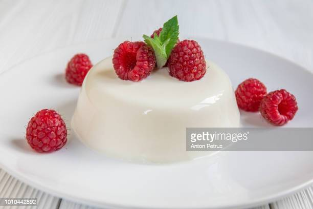 Panna cotta with raspberry, decorated with fresh mint