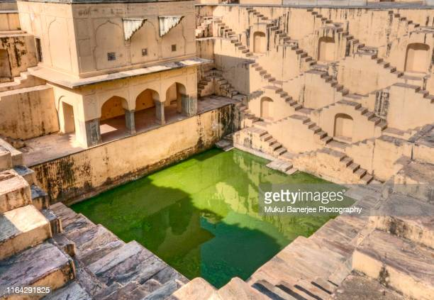 panna meena ka kund step-well near amber fort at jaipur, rajasthan - india - stepwell stock pictures, royalty-free photos & images