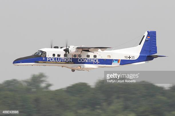 CONTENT] Panned shot of RUAG Do228NG 9835 of the German Navy Seen after takeoff at RAF Fairford following the 2013 Royal International Air Tattoo