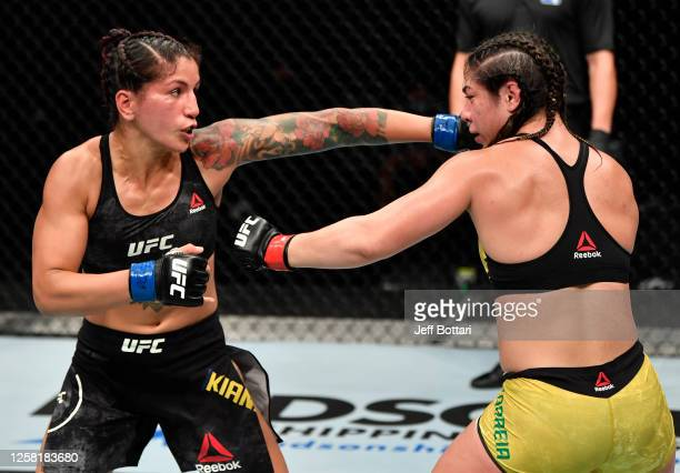 Pannie Kianzad of Iran punches Bethe Correia of Brazil in their bantamweight fight during the UFC Fight Night event inside Flash Forum on UFC Fight...