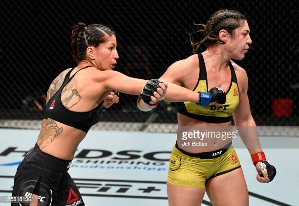 Pannie Kianzad of Iran punches in their bantamweight fight during the UFC Fight Night event inside Flash Forum on UFC Fight Island on July 26 2020 in...