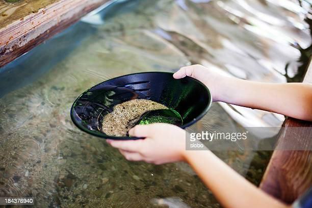 panning for gold - california gold rush stock photos and pictures