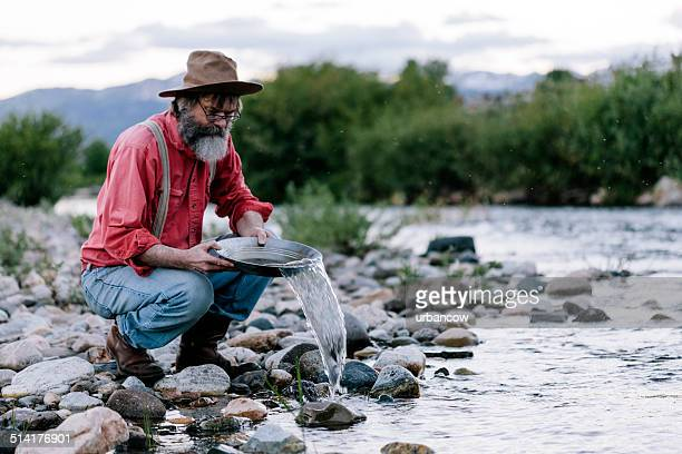 panning for gold, yellowstone - gold rush stock photos and pictures