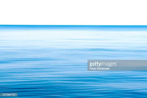 panning on sea at dawn - 水面 ストックフォトと画像