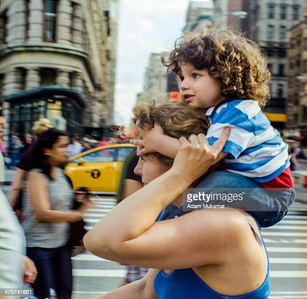 CONTENT] Panning shot of child on mother's strong shoulders Linhof technika press Zeiss 53mm