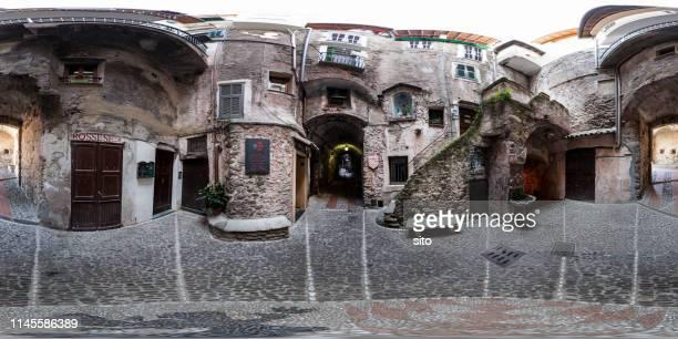 360 panorama at an alley in a mediaval town in dolceacqua, italy - vista de 360 graus imagens e fotografias de stock