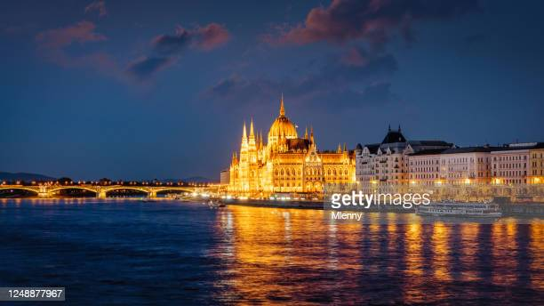 panorama budapest hungary sunset twilight parliament building danube river - hungary stock pictures, royalty-free photos & images