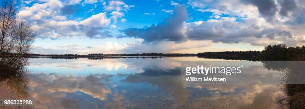 panorama 'cloudy reflections' - william mevissen stock pictures, royalty-free photos & images
